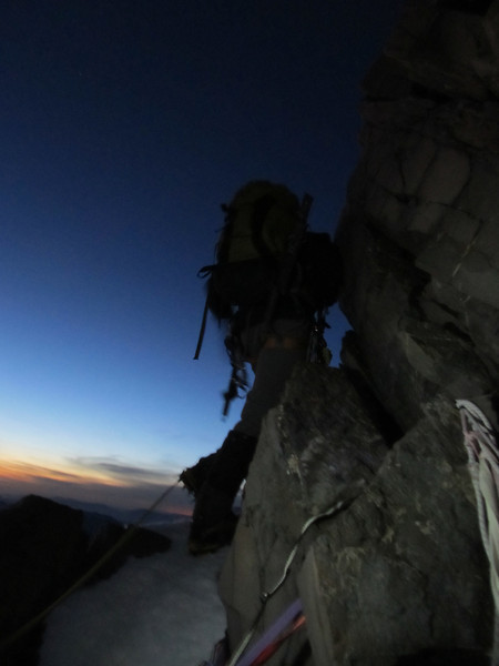 First pitch on the summit rocks at sunrise.
