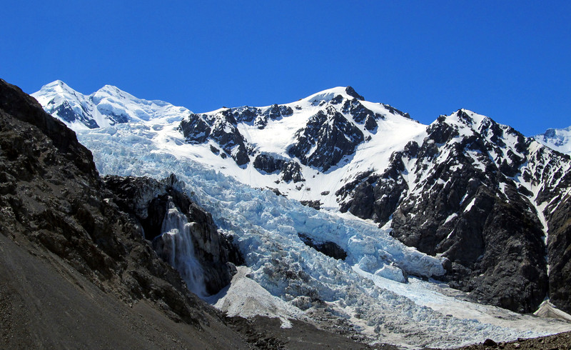 Hochstetter Icefall with Silberhorn and Tasman above. Plateau Hut can be seen just right of the icefall on the ridge.