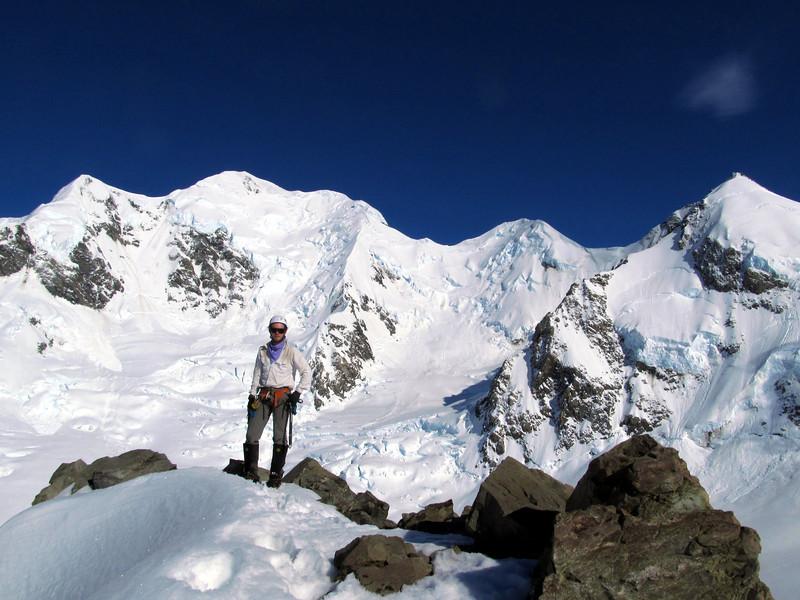 On top of Glacier Dome, Silberhorn and Tasman behind. Syme ridge runs just above James' head.