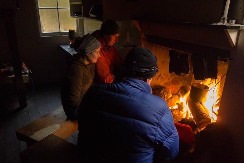Enjoying the warming open fire.
