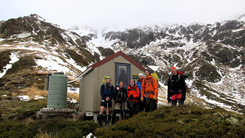 The team at Devils Den Bivouac, the gully we climbed above.