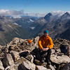 James on the summit looking odown the East Sabine, Cupola and Travers Peak on the right.