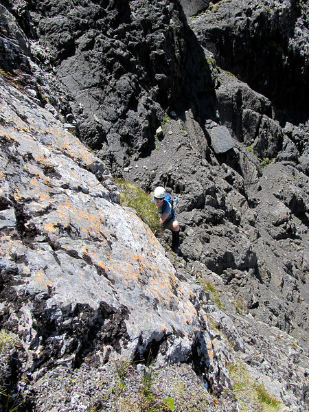 Marta climbing through the band of bluffs intersecting the scree chute.