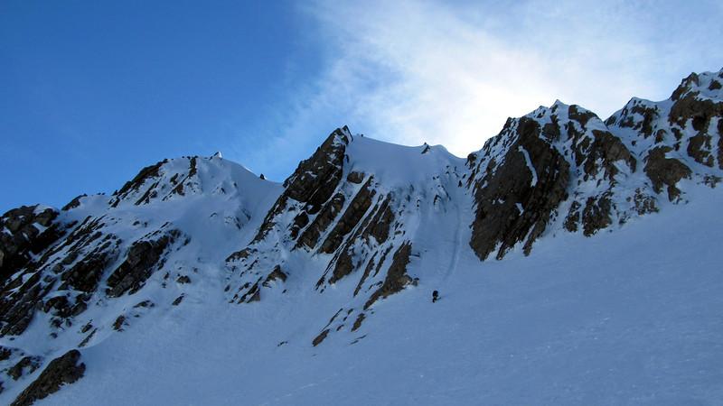 Marta and James downclimbing a steep icy gully on the Matakitaki side.