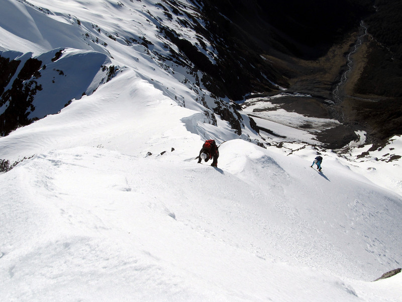 Andrew and Marta climbing the final steep summit ridge. Glacier Gully below.