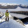 Me on the summit of Mt Una, Matakitaki valley below in cloud.
