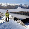 Me on the summit of Mt Una, Matakitaki valley below in cloud.