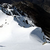 James downclimbing Pt 2130m, Glacier Gully below.