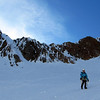 Marta descending the upper basin on the Matakitaki side of Mt Una, James downclimbing the gully on the left.