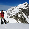 Me back on Pt 2130, the north east ridge of Mt Una with the crux rock step behind.