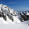 Andrew descending the upper basin on the Matakitaki side of Mt Una - Pt 2200m on the left.
