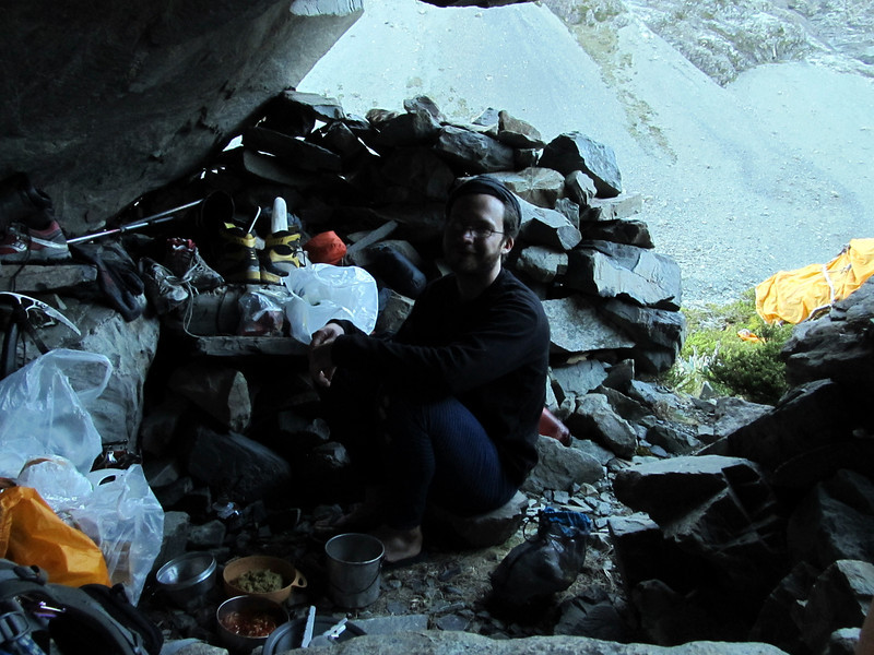 James preparing dinner in the Sinclair Rock Biv.