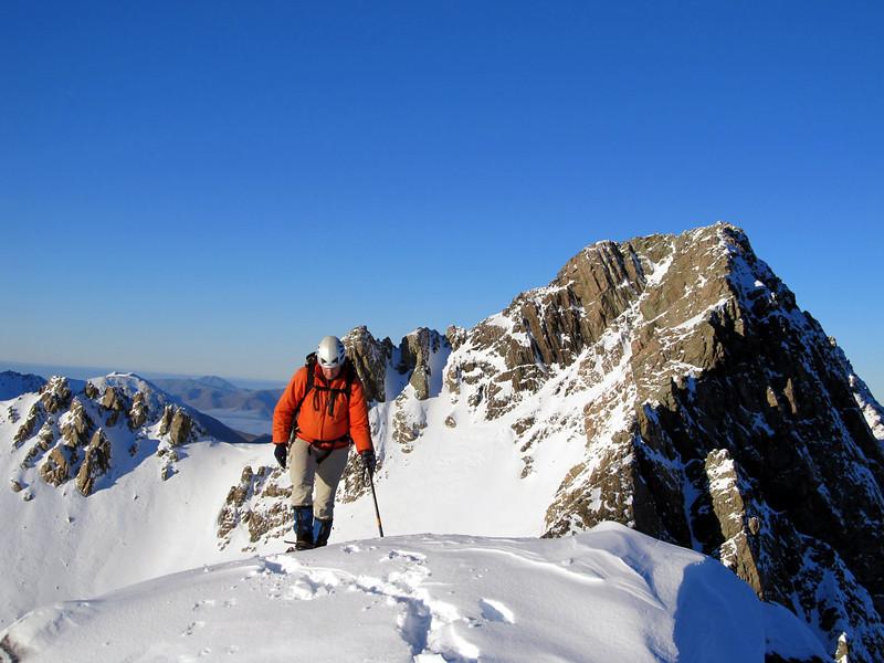 Aaron reaching the summit of Hakatere Peak, South Peak behind.
