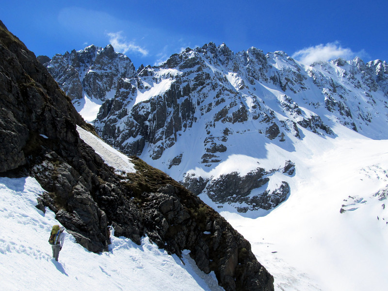 James approaching the rockstep that gives way to the easier snow slopes above. Couloir Peak on the left, Twins in the centre, Cameron Glacier below.