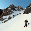 James climbing towards the central couloir on Arrowsmith.