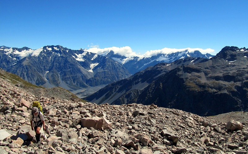 James gaining height towards our camp at 2000m. Godley Valley behind.