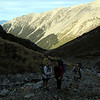 The team below the saddle between Boulderstone and Kakapo Streams, Boulderstone Stream below.