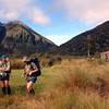 James and Max below Mt Newton, Grassy Flat Hut on the right.