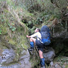 Climbing over boulders in the Tuke River.