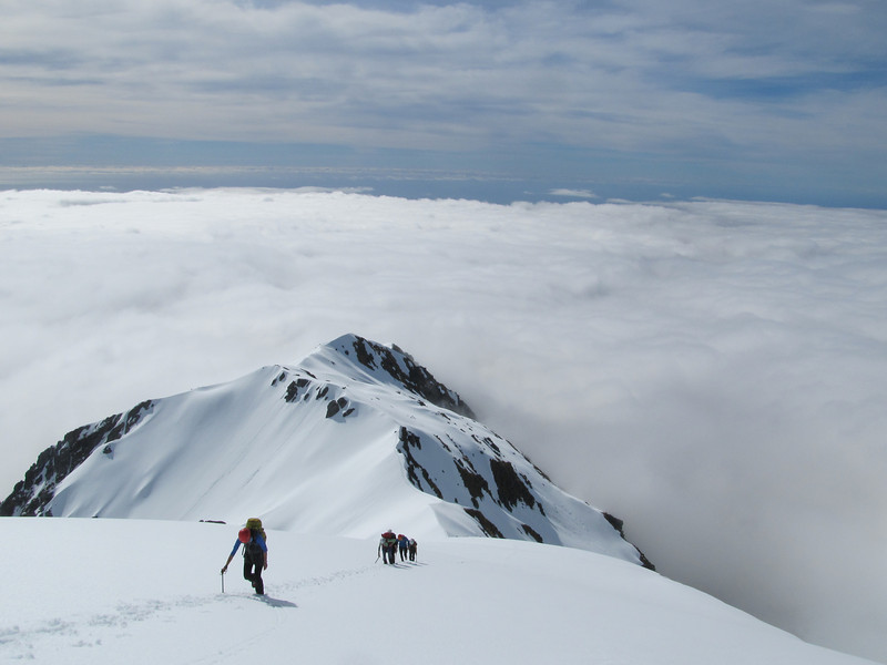Climbing the final snow slope to the summit ridge of Mt Adams.