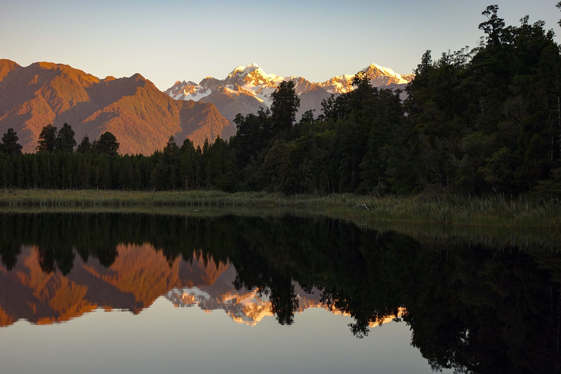 Sunset at Lake Matheson with Mt Tasman and Cook.