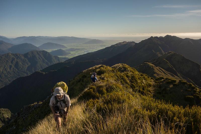 Reaching tussock, the ridge we traversed behind.