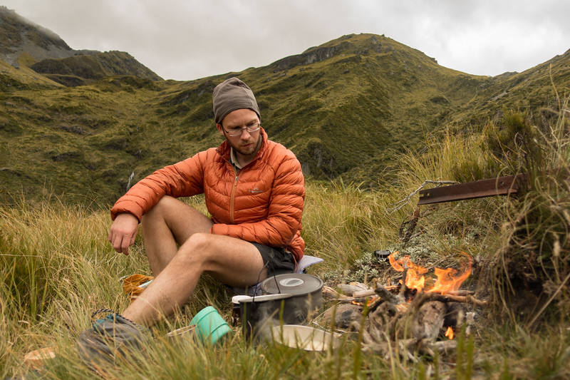 Enjoing a warming scrub fire by the hut.