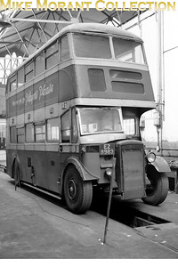Belfast bus Fleet no. 138 with registration EZ 8983 was a 1938 built Daimler COG5 10347 with Harkness/Park Royal H52R B5082 body and was withdrawn in 1963 following about eight years in use as a driver training vehicle. The date of this picture is unknown but John Knox has kindly written to tell us all that this bus is in the Falls Road depot and the inspection pit is a former tram inspection pit. [Mike Morant collection]