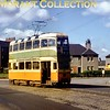 Glasgow Coronation tram No. 1171 depicted in service in August 1959. Although I took the picture the location isn't recalled but Brian Longworth has kindly informed me that that it's Baillieston whilst John Conroy has been even more specific that the location is on Baillieston Main Street at the corner of Martin Crescent.<br> [Original slide by <i>Mike Morant</i>]