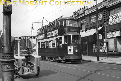LPTB Type UCC (ex-LUT 'Feltham') No.2138 photographed passing by Acton library about October 1936 whilst operating Service 7 Uxbridge to Shepherds Bush. London Transport have now repainted the car into its standard livery and fitted a plough carrier in readiness for transfer the following month to Streatham depot Note that gem of an ice cream cart! [Mike Morant collection]