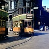 Glasgow Corporation Tramways 4-wheeled trams pass each other at St. George's Square in August 1959. Car no. 48 is on route 30 to Dalmarnock.<br> [Original slide by <i>Mike Morant</i>]