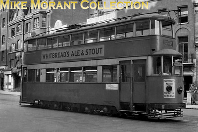 On 17/8/71945 London Transport  Ex-MET 'Feltham'tram no. 2117 is in Vauxhall Bridge Road waiting to get into a platform to terminate at the Victoria terminal. The 'via Brixton' blind indicates it will return to Tooting Broadway via Stockwell, Brixton and Streatham on service 20 and thence back to Victoria via Balham, Clapham and Stockwell. The reverse of that loop was service 8.  [R. H. G. Simpson / Mike Morant collection]