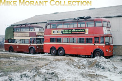 London Transport C2 class trolleybus no. 260 and Reading no. 113 stored alongside Smith's garage at Whitley near Reading in February 1963. What looks like snow was so compacted that the whole area visible here was solid ice. [Slide taken by Mike Morant]