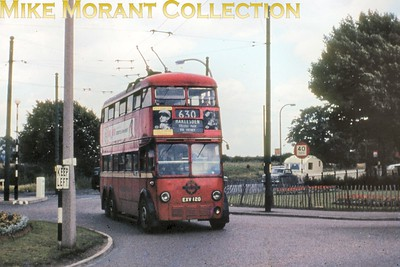 London Transport K1 class trolleybus no. 1120 is shown here on the 630 route at the roundabout close to Mitcham in 1960. [Slide taken by Mike Morant]