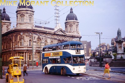 Hull 'Coronation' trolleybus no. 102 turning into Paragon St under what was then the new one way system. Kodachrome processing date AUG64. [Mike Morant collection]