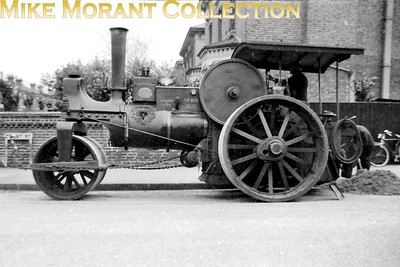 Croydon Corporation steam road roller in Frant Road, Thornton Heath. This engine was an Aveling & Porter 'R16' type of engine built in 1886 and is seen here with fleet number SR 600 and licence plate BY 2185. Brigstock Road is to the left in this shot and it's interesting to note that the roller is in steam and there are two council employees present. There are two bicycles in this shot but neither of them was mine. This engine has survived and is in the custodianship of The Science Museum. [Photo taken by Mike Morant]