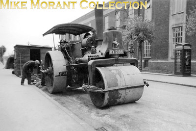 Croydon Corporation steam road roller in Frant Road, Thornton Heath. This engine was an Aveling & Porter 'R16' type of engine built in 1886 and is seen here with fleet number SR 600 and licence plate BY 2185. Brigstock Road is behind the camera in this shot with the erstwhile telephone exchange on the right and we are lookning towards Mayday Hospital.  It's interesting to note that the roller is in steam and there are two council employees present. This engine has survived and is in the custodianship of The Science Museum. [Photo taken by Mike Morant]