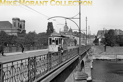 A superb view scanned from a large glass negative featuring Thionville tram no. 4 on route (or line) 3 crossing the bridge over the river Moselle. This is an original negative that was almost certainly used as the basis for a commercial postcard. It isn't dated but it's worth noting that all the women visible in the background are attired in knee-length apparel which suggest, perhaps, 1930-ish. [Mike Morant collection]