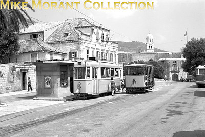 Yugoslavian   - but Croation today -  Dubrovnik tram car no. 12 and open trailer car no. 25. N.B. This image, presumably misappropriated from its eBay listing, is shown at least twice on the Tramvaj u Dubrovniku (povijest) web forum. What you are viewing here is scanned from the original negative which I own lock, stock and barrel. [Mike Morant collection]