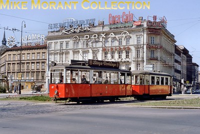 Austrian tram. Vintage Vienna 4-wheeled tram car no. 27 and trailer photographed on 23/2/66. [Mike Morant collection]