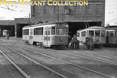 Cincinnati Street RailwayCars 109, a 1928-built Peter Witt, and 2506, a 1926-built curved-side lightweight, ex-Maumee Valley Rys (Toledo, Ohio) car, at the Vine Street car barn.  Car 2506 is to be used on a fan trip.  Photo taken in 1950.CAPTION TEXT KINDLY SUPPLIED BY CLIFF SCHOLES.