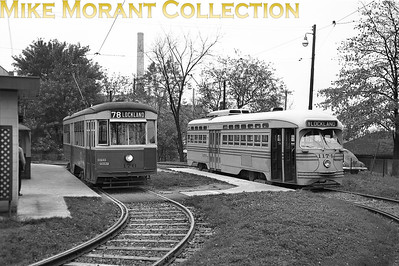 Cincinnati Street RailwayCars 176 , a 1928-built Peter Witt, and 1174, a 1947 St. Louis Car Co. built PCC, in the loop off Anthony Wayne Avenue at Millsdale Avenue.  This was the new loop for Route 78-Lockland, opened on July 10, 1949, a cut-back of the original Lockland line because officials in that suburb wanted to remove the tracks from their streets. Note, also, the use of only one trolley pole, as this location was outside the city limits of Cincinnati and only one pole was used north of Mitchell Avenue on route 78.CAPTION TEXT KINDLY SUPPLIED BY CLIFF SCHOLES.