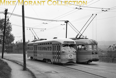 Cincinnati Street RailwayCars 1170 and 1119, 1947 and 1940 (respectively) St. Louis Car Co. built PCC's on Wilder Avenue between Warsaw and Glenway Avenues. Car 1170 is outbound on route 35-Warsaw/Price Hill; car 1119 is inbound on the same route.  Photo taken in 1949.CAPTION TEXT KINDLY SUPPLIED BY CLIFF SCHOLES.
