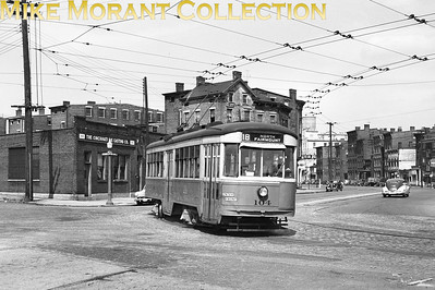 Cincinnati Street RailwayA 1948 shot of car 104, a 1928-built Peter Witt, turning from McLean Street onto Western Avenue, inbound on Route 18-North Fairmount.CAPTION TEXT KINDLY SUPPLIED BY CLIFF SCHOLES.