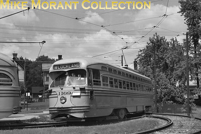 Cincinnati Street RailwayCar 1169, a 1947-built St. Louis Car Co. PCC,  in the Route 78-Lockland loop off Anthony Wayne Avenue at Millsdale Avenue.  This loop was opened on July 10, 1949, a cut-back of the original Lockland line as officials of that suburb wanted to remove tracks from their streets.  Photo taken in 1949. Note the use of only one trolley pole, as this location is outside the city limits of Cincinnati and only one pole was used north of Mitchell Avenue on route 78.CAPTION TEXT KINDLY SUPPLIED BY CLIFF SCHOLES.