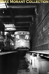 Cincinnati Street RailwayCar 1128, a 1939-built Brilliner inside the Brighton car barn, signed for Route 62-Ohio Ave., a line it never traversed except on a fan trip.  Photo taken in 1950.CAPTION TEXT KINDLY SUPPLIED BY CLIFF SCHOLES.