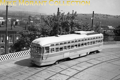 Cincinnati Street RailwayCar 1154, a 1947-built St. Louis Car Co. PCC on Wilder Avenue between Glenway and Warsaw Avenues inbound on Route 35-Warsaw/Price Hill.  Photo taken in 1949.CAPTION TEXT KINDLY SUPPLIED BY CLIFF SCHOLES.