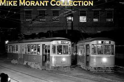 Cincinnati Street RailwayCars 197 and 146, 1928-built Peter Witts, outside the Vine Street car barn.  Taken on April 28, 1951, the evening before streetcar operations ended in Cincinnati.  Car 197 is being prepared for a private charter.CAPTION TEXT KINDLY SUPPLIED BY CLIFF SCHOLES.