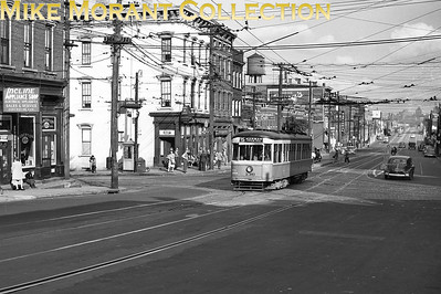 Cincinnati Street RailwayCar 136, a 1928-built Peter Witt, on Eighth Street crossing State Avenue outbound on Route 35-Warsaw/Price Hill.  Photo taken in 1950.CAPTION TEXT KINDLY SUPPLIED BY CLIFF SCHOLES.
