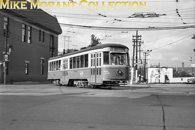 Cincinnati Street RailwayCar 129, a 1928-built Peter Witt, turning from Beekman Street onto Harrison Avenue, inbound on Route 18-North Fairmount.  Photo taken in 1948.CAPTION TEXT KINDLY SUPPLIED BY CLIFF SCHOLES.